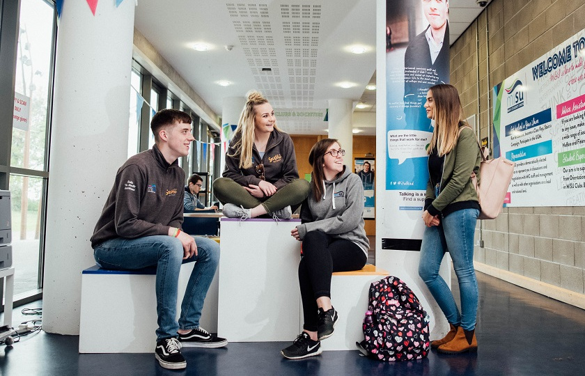 4 students hanging out in the Mary Immaculate Students' Union (MISU) area at MIC Limerick